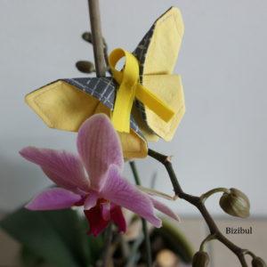 un papillon origami en soutien à la lutte contre l'endométriose